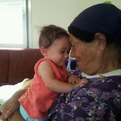 Miriam with her great granddaughter.